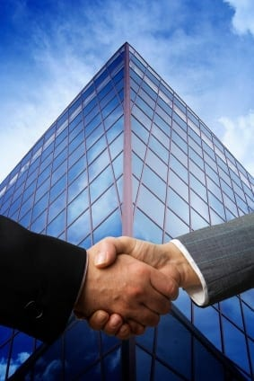business-building-handshake