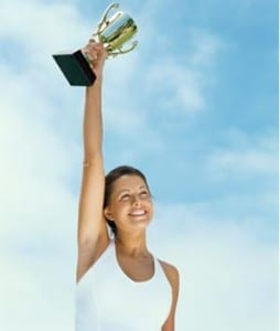 success - Portrait of excited teenage girl with trophy