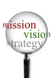mission vision strategy through magnifying glass