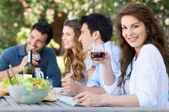 Group Of Friends Eating Outdoors