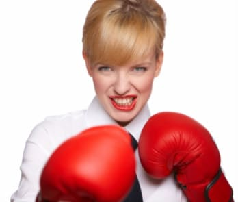1351080437 - Business-Woman-with-Boxing-Gloves-e1354843409486