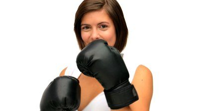 stock footage brown haired woman with boxing gloves isolated on a white background - 1351080437