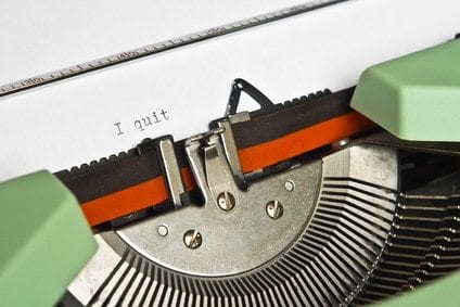 """Close-up of an old typewriter with the word """"I quit"""" typed"""