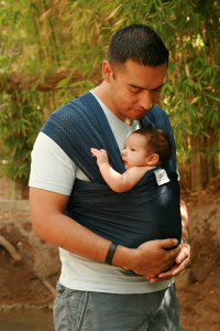 The wrap can be worn in many different ways to accommodate baby size and your comfort.