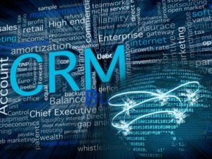 CRM related terms in blue and a big world sphere with the American state in front, made with zeros and ones numbers for a business, software and communication concept.