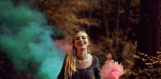"""smiling girl with color firecracker"""